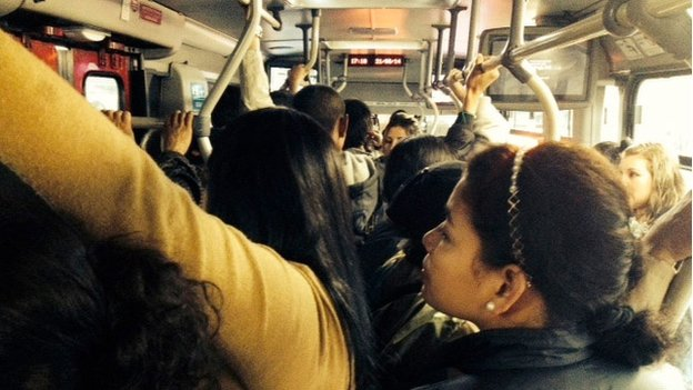 Passengers on board a Transmilenio bus in Bogota
