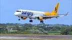Aurigny Embraer 195 jet coming in to land at Guernsey Airport