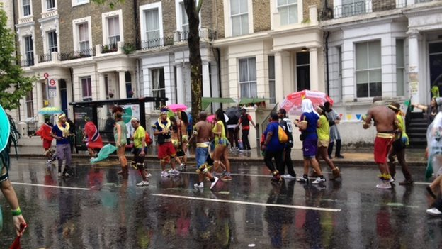 Carnival goers brave the wet weather in Notting Hill on Bank Holiday Monday