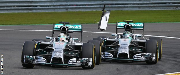 Rosberg (right) clips the back of Hamilton's car
