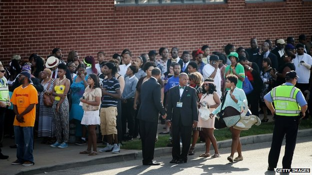 Guests wait in line to enter the Friendly Temple Missionary Baptist Church in St Louis