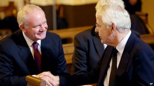 Martin McGuinness and Sir John Major shook hands