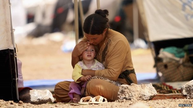 A Yazidi Iraqi woman and her child at at the Nowruz refugee camp in Qamishli, Syria (17 August 2014)