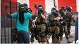 Police confront a civilian in Ferguson, Missouri