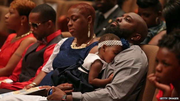 Michael Brown's mother Lesley McSpadden (far left) sits near Michael Brown Snr (right) at their son's funeral