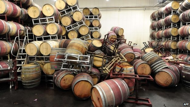 Barrels are strewn about inside the storage room of Bouchaine Vineyards in Napa, California after a 6.1 Earthquake struck the area on 24 August 2014