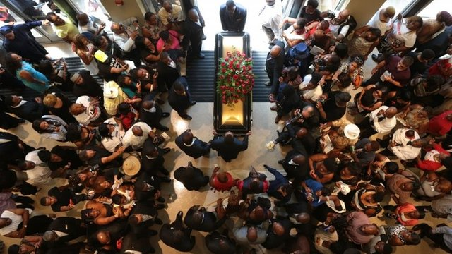 Michael Brown's casket leaves church