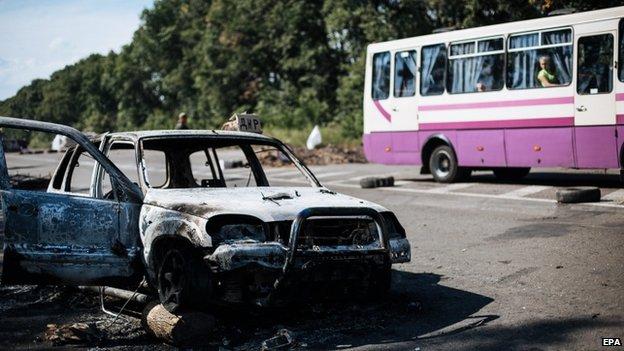 Destroyed car near eastern Ukrainian town of Rassypnoe. 25 Aug 2014