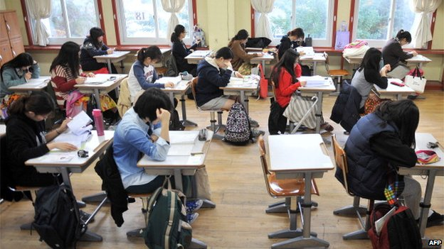 South Korean students prepare to take the College Scholastic Ability Test, a standardised exam for college entrance, at a high school in Seoul on 7 November 2013