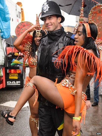 Police officer with a reveller at Notting Hill Carnival
