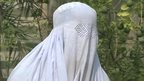 Woman with white veil covering face in Bannu
