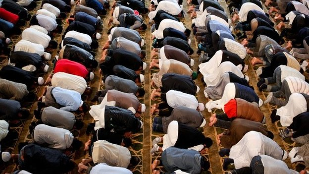 Men kneeling in prayer at a mosque