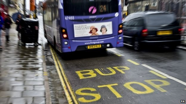 Bup stop sign in Bristol with bus stopping