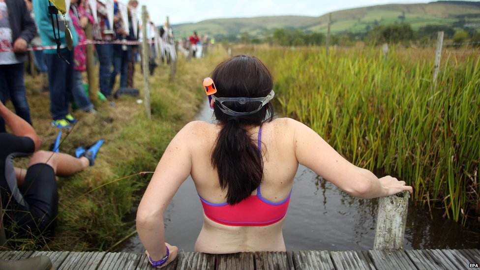 Llanwrtyd Wells bog snorkelling championships 2014 - Woman gets ready to take part