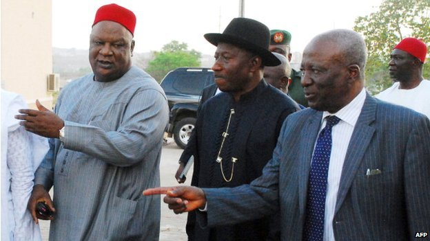 Nigerian President Goodluck Jonathan (C) accompanied by Nigerian Government Secretary and Senator Anyim Pius Anyim (L) and conference chairman Justice Idris Kutigi arrive to attend the inauguration of the national conference to tackle the country's burning issues in Abuja on March 17, 2014