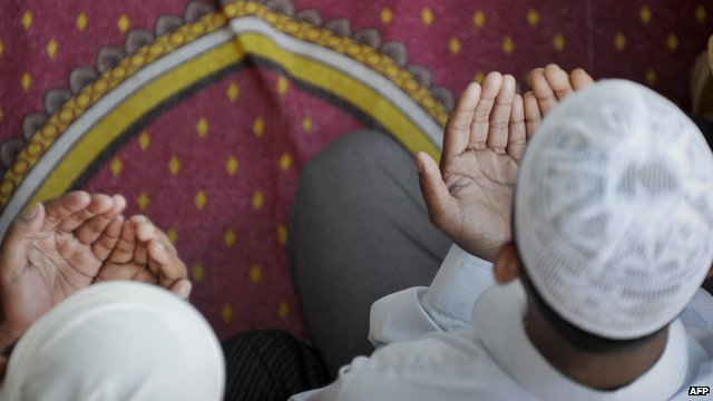 Muslim boys praying