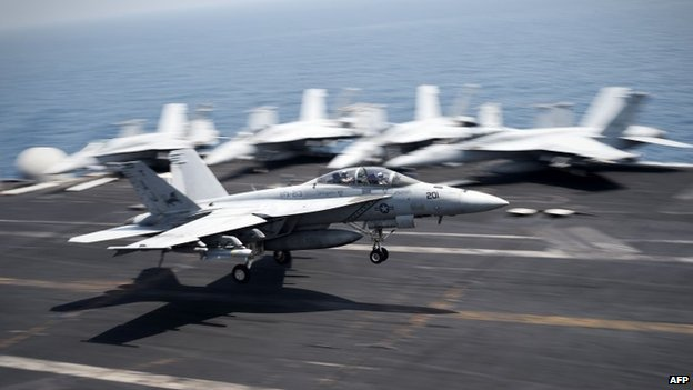 An F/A-18C Hornet returning from Iraq lands on USS George H W Bush (15 August 2014)