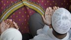 Muslim boys praying