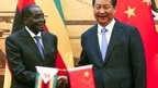 Zimbabwean President Robert Mugabe, and his Chinese counterpart Xi Jinping shake hands during a signing ceremony at the Great Hall of the People in Beijing, China, Monday 25 August 2014
