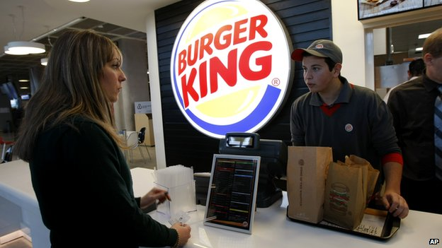 A woman orders at a Burger King counter