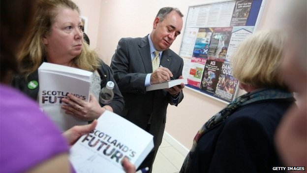 Alex Salmond signs copies of the White Paper on independence
