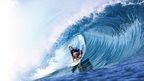 A man rides a wave during the Billabong Pro Tahiti surf event on the French Polynesian island of Tahiti.