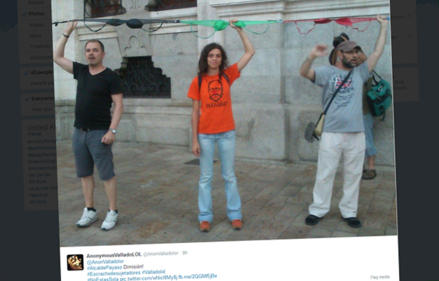 Residents of Valladolid tie a chain of bras around the entrance to the town hall