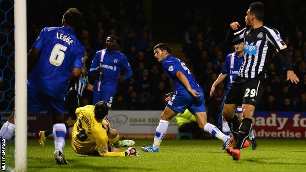 Gillingham's John Egan puts into his own net