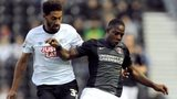 Derby County's Ryan Shotton (left) and Charlton Athletic's Franck Moussa battle for the ball
