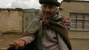 An elderly Bolivian indigenous woman begs for money in El Alto, Bolivia on Friday, Jan. 27, 2006.
