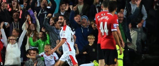 Will Grigg celebrates MK Dons second goal against Manchester United