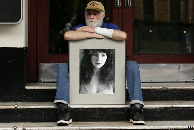 Kate Bush fan Ian Harris, 67, from London, with his photographic print of the singer, at the Hammersmith Apollo, London