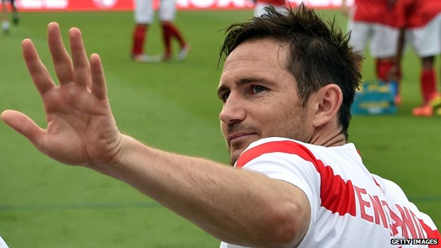 Frank Lampard waves from the England bench during a 2014 friendly with Honduras