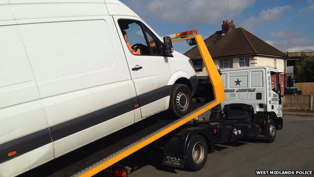 White van being towed away