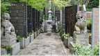 Stone-carved guardian dogs sit at the entrance of a memorial compound honoring World War II-era war criminals in Koyasan Okuno-in temple in Koya town, Wakayama prefecture, central Japan, Wednesday, 27 Aug 2014.
