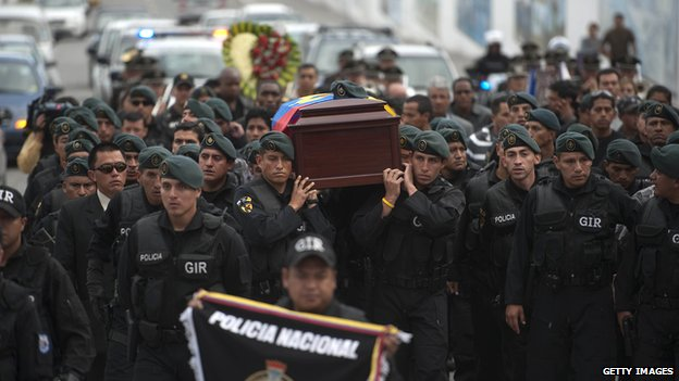 Members of an elite police special operations unit carry the coffin of their colleague Froilan Jimenez on 1 October 2010.