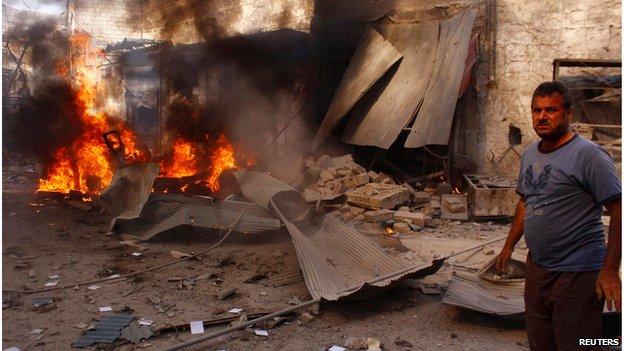A man near site of alleged barrel bomb in Aleppo August 13 2014