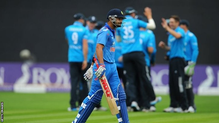 England players celebrate in the background after dismissing India batsman Virat Kholi