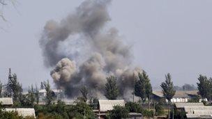 Smoke from shelling rises over Novoazovsk, eastern Ukraine, 27 August