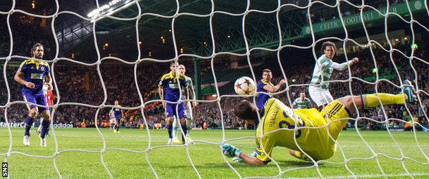 NK Maribor goalkeeper Jasmin Handanovic makes a save to deny Celtic defender Virgil van Dijk