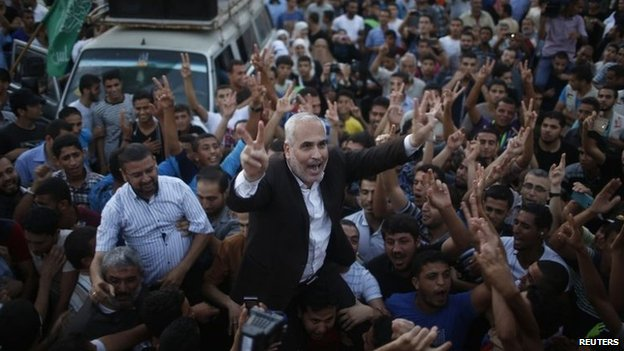 Hamas spokesman Fawzi Barhoum celebrates in Gaza City after the ceasefire announcement (26 August 2014)