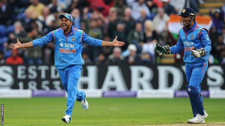 India fielders MS Dhoni (r) and Suresh Raina celebrate