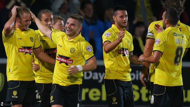 Burton players celebrate