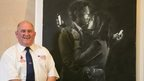 Dennis Stinchcombe with Banksy artwork