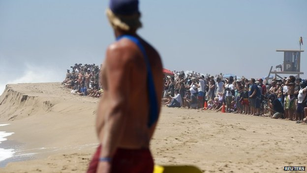"A lifeguard watches swimmers at ""The Wedge"" wave break in Newport Beach, California August 27, 2014."