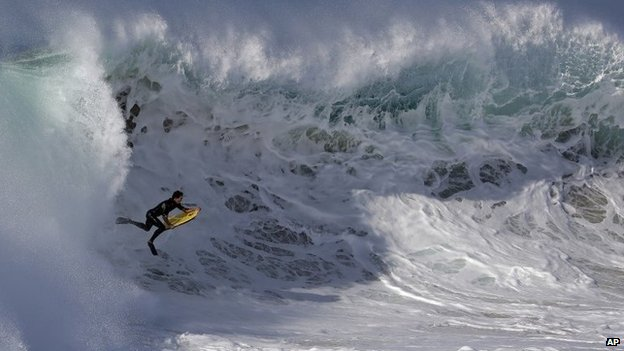 A bogieboarder rides a wave at the wedge in Newport Beach, California 27 August 2014
