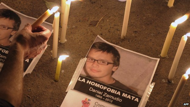 People light candles to pay homage to Chilean Daniel Zamudio, in front of the Chilean embassy in Argentina, on March 30, 2012.