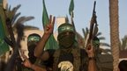 Palestinian militants from the Ezzedine al-Qassam Brigades, Hamas's armed wing, take part in a rally in Gaza City