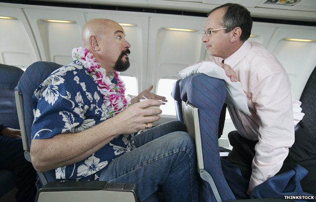 Two men on a plane disagree about one reclining his seat