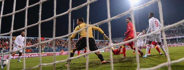 Wayne Rooney scores against Montenegro in a World Cup qualifier in 2013